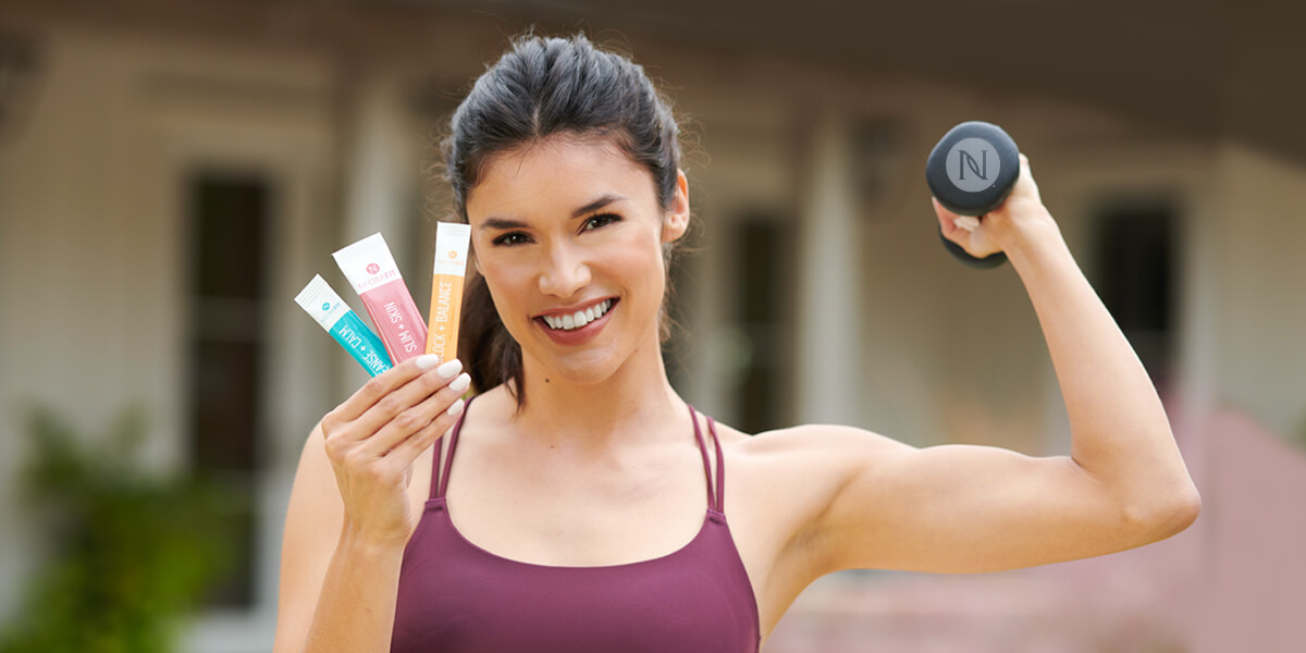 A woman holding NeoraFit products.