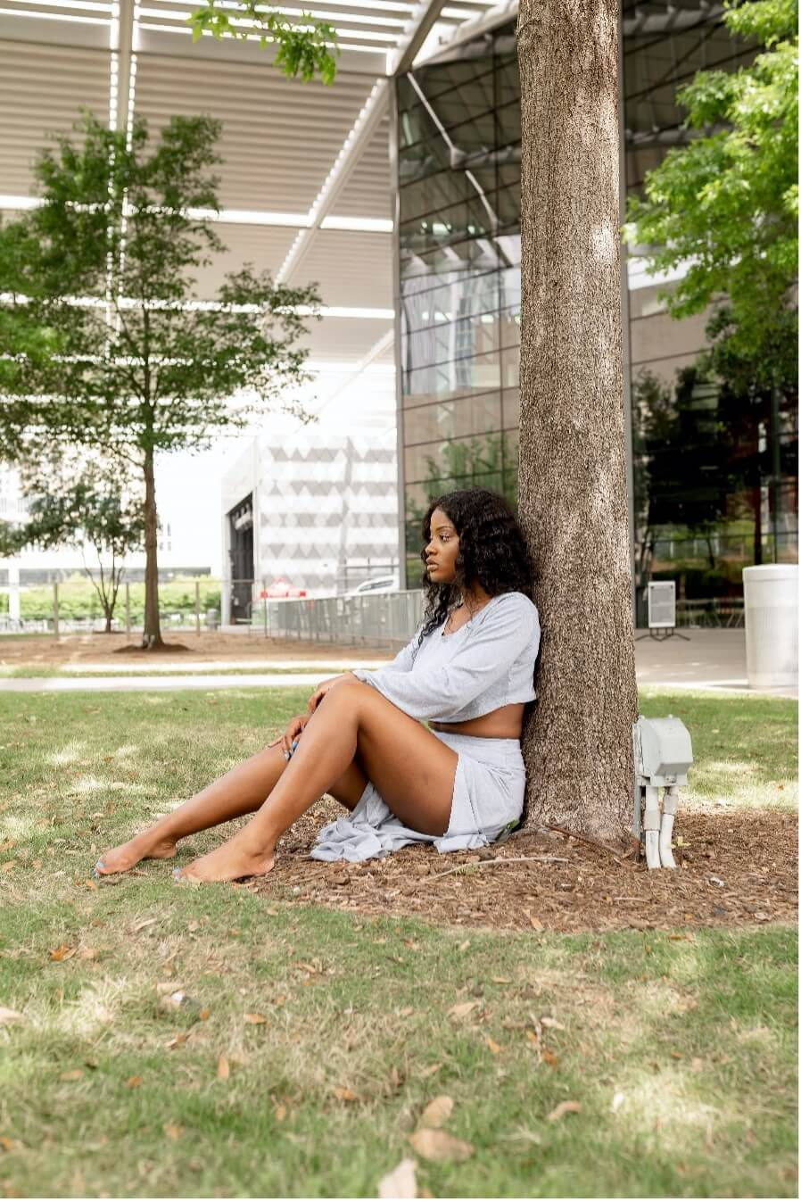 Brittany Giles sitting next to a tree